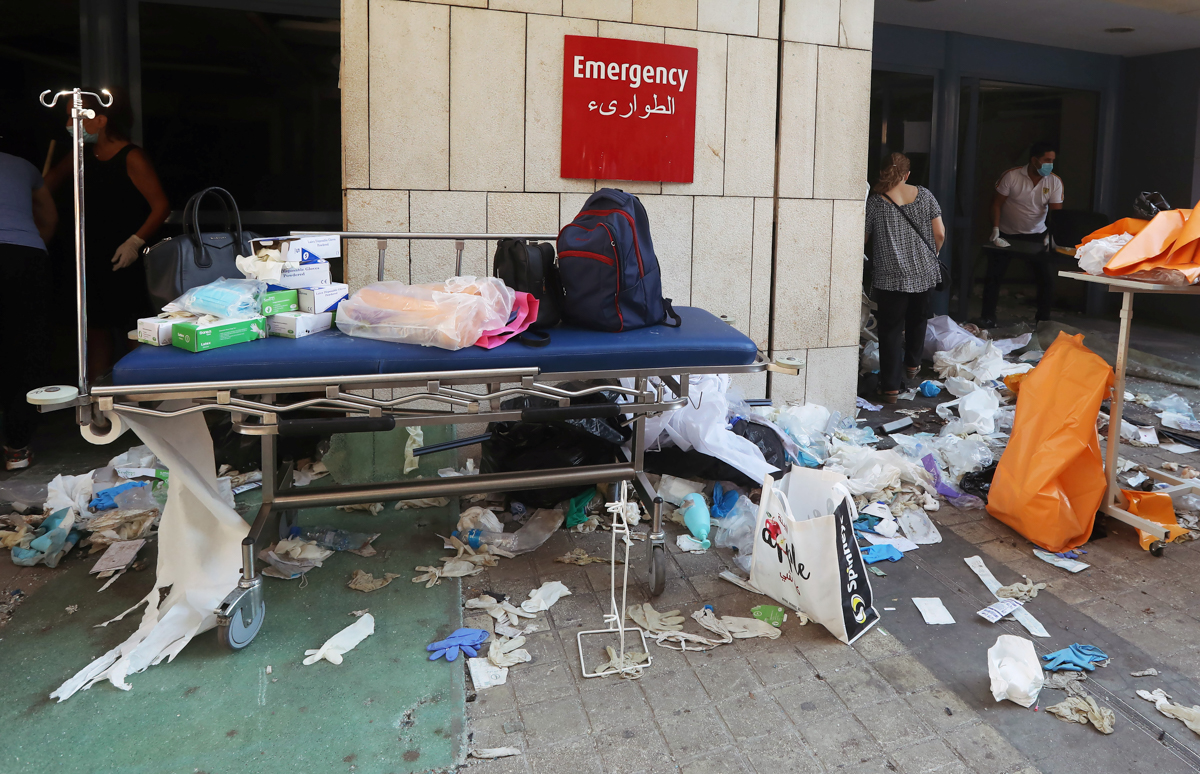 Protective gloves are scattered at a damaged hospital following Tuesday's blast in Beirut
