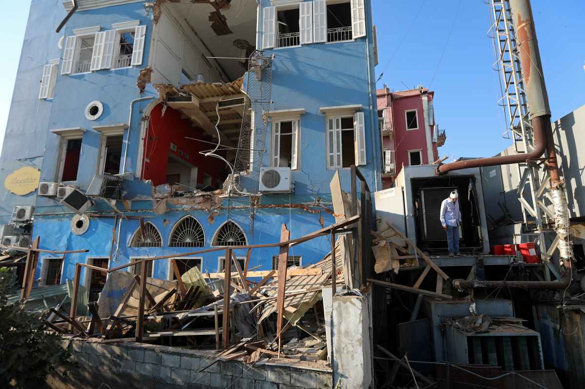 A man inspects the damage following Tuesday's blast in Beirut's port area